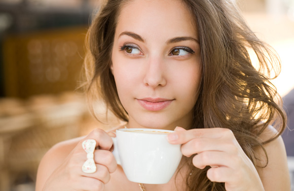 young-brunette-enjoying-cup-of-coffee
